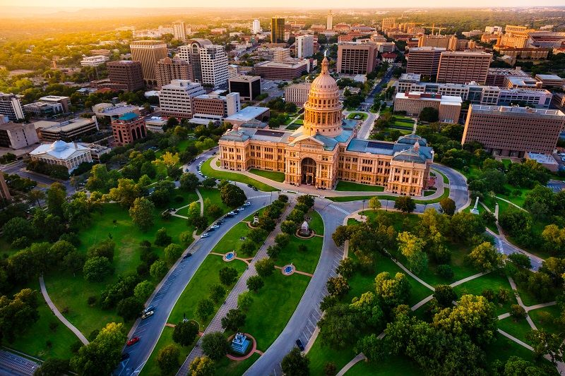 Capitol-building,-aerial-skyline,-sunset,-Austin,-TX,-Texas-State-Capital-cm