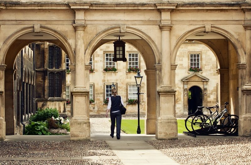 Student-passing-through-a-college-campus-in-Cambridge-Universitiy-cm