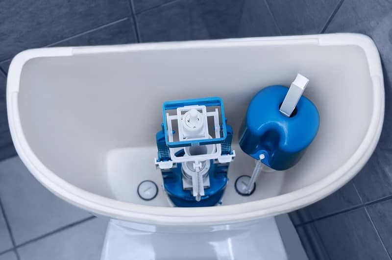 New plastic fittings in a clean toilet. Plumbing repair.-cm