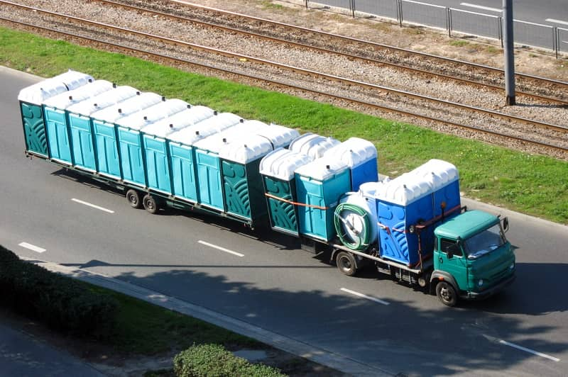 Old truck driving with portable toilets-cm