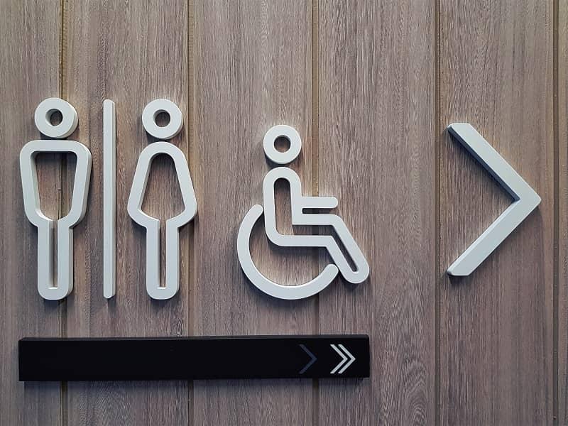 White Toilet Symbols on Wooden Plank Wall-1-cm